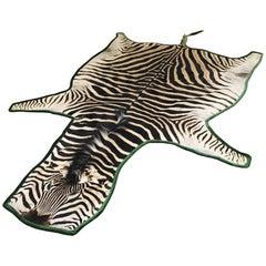 Forsyth Zebra Hide Rug Trimmed in Emerald Green Velvet