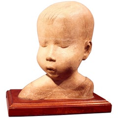 Early 20th Century Carved Stone Bust of a Young Child