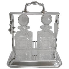 Two Bottle Tantalus or Lockable Liquor Frame by John Grinsell & Sons