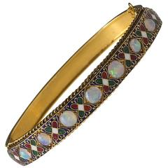 English Victorian Opal, Enamel and Gold Holbeinesque Bangle Bracelet