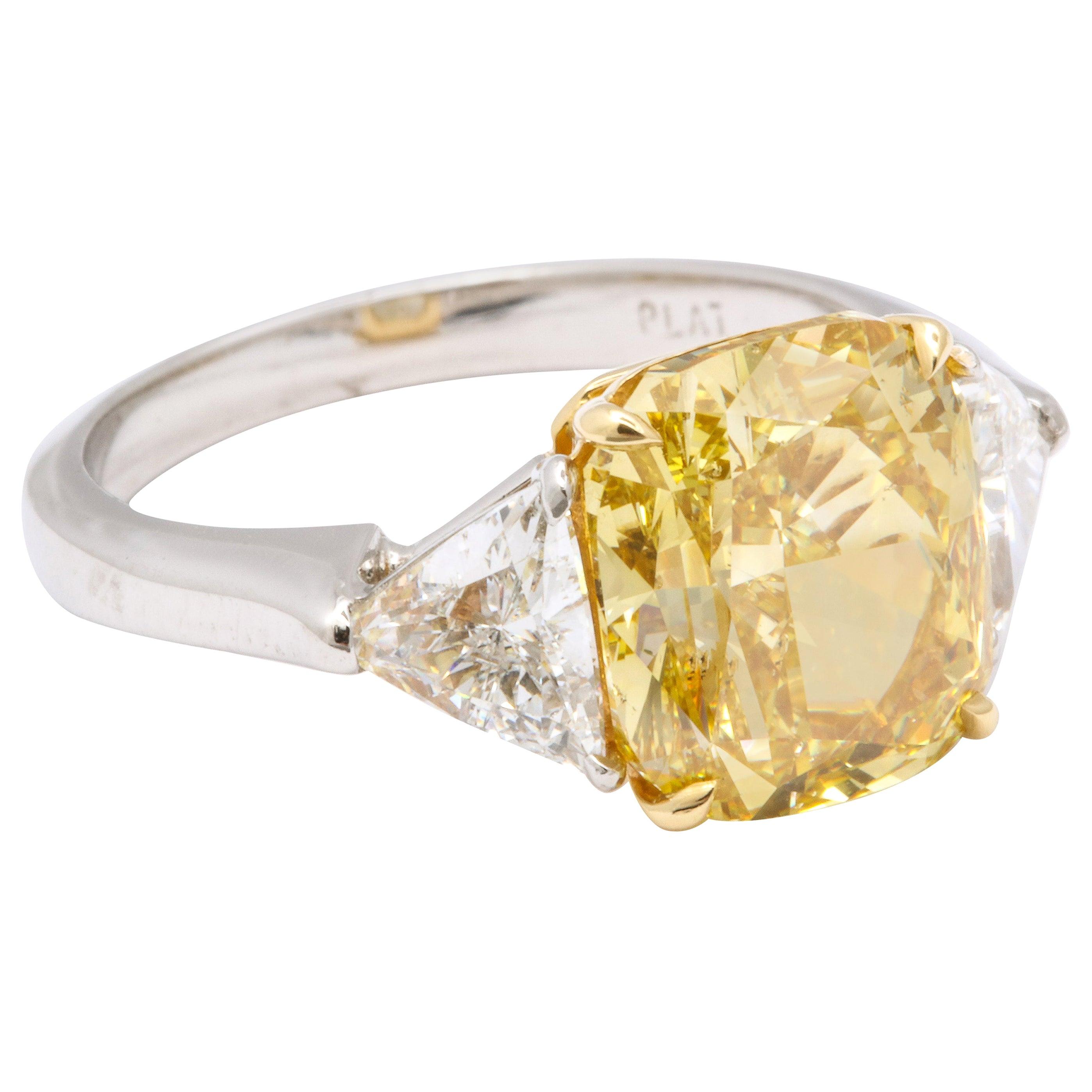 GIA Certified 4 Carat Fancy Intense Yellow Diamond Ring