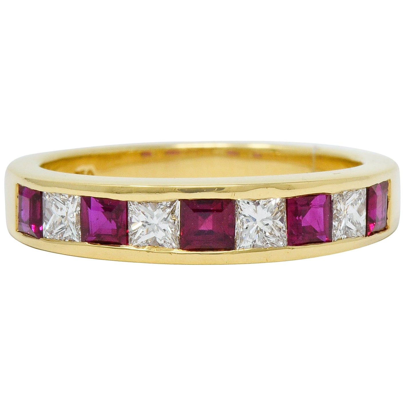 Tiffany & Co. Ruby Diamond 18 Karat Gold Channel Band Ring, circa 1990