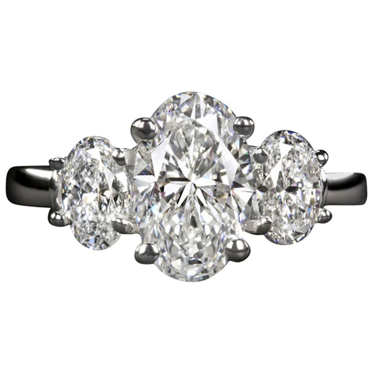 Ags GIA Certified Three-Stone 3 Carat Oval Diamond Platinum Ring
