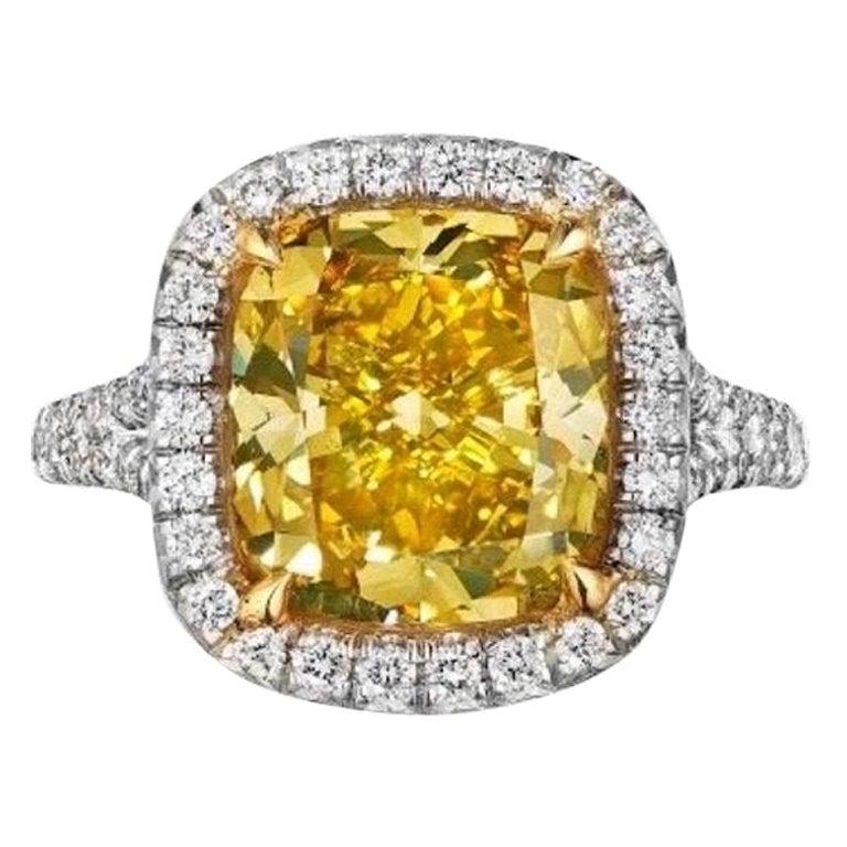 GIA Certified 5.05 Carat Vivid Yellow Cushion Cut Diamond Ring