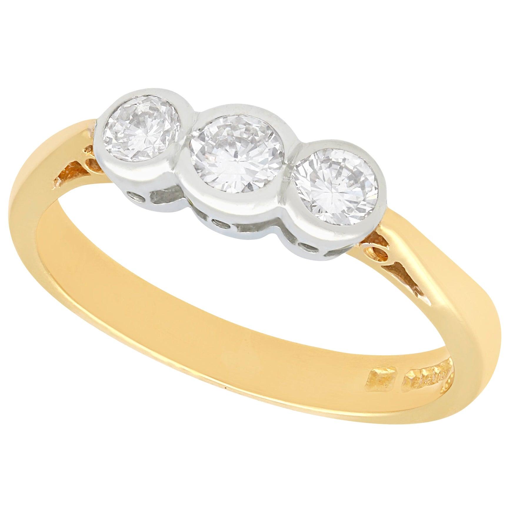 Diamond and Yellow Gold Three-Stone Engagement Ring