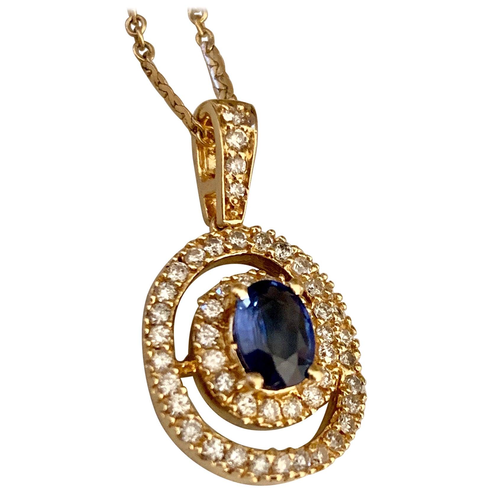 Modern Oval Sapphire and Diamond 14 Karat Yellow Gold Pendant