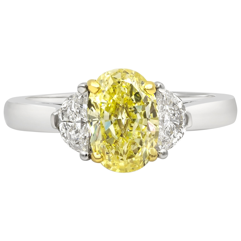 GIA Certified 1.50 Carat Intense Yellow Oval Diamond Three-Stone Engagement Ring