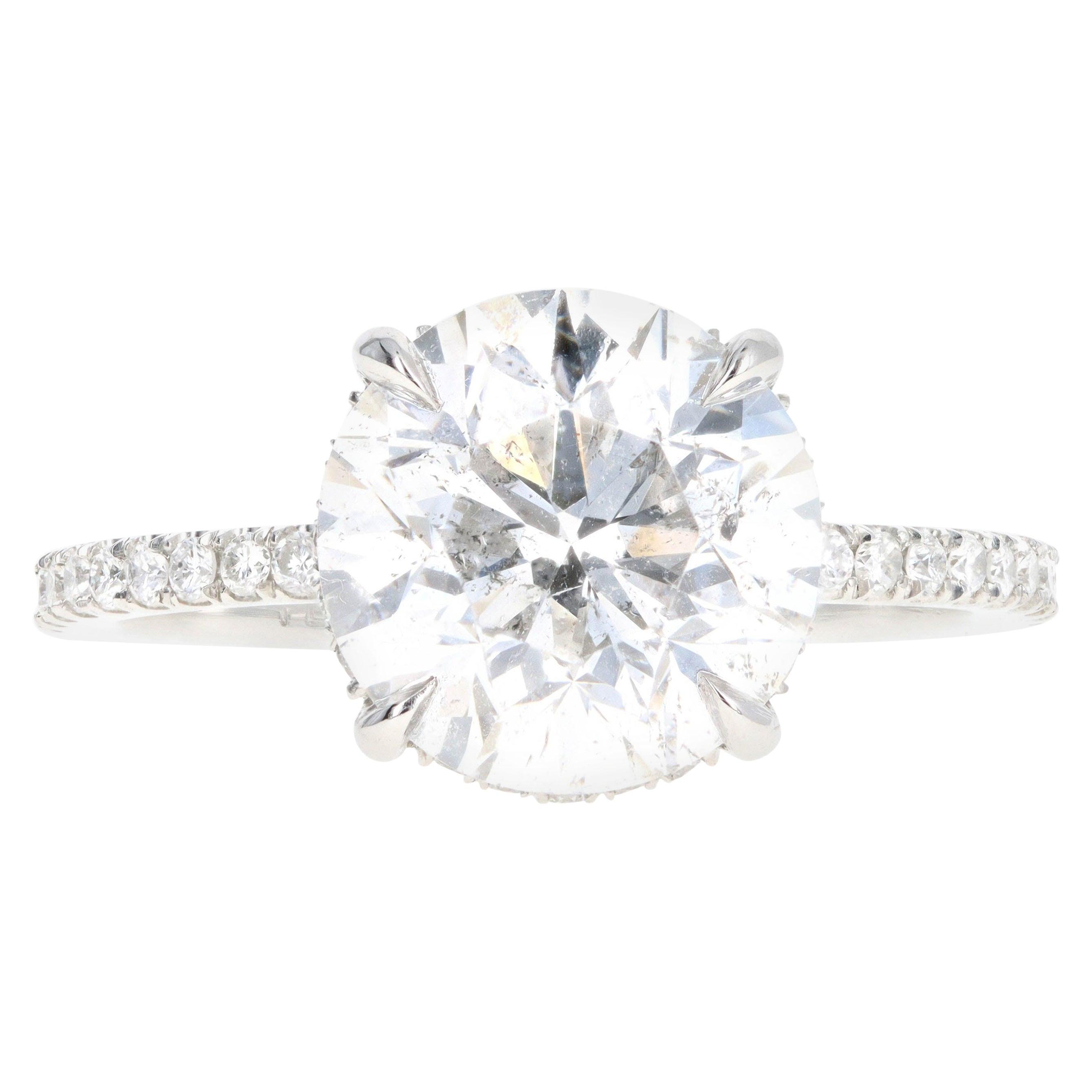 Platinum 3.92 Carat Round Brilliant Diamond French Halo Engagement Ring