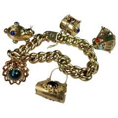 Vintage 1950s Italian 18 Karat Yellow Gold Etruscan Revival Charm Bracelet