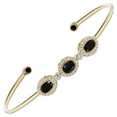 14 Karat Yellow Gold Black Spinel and Diamond Triplet Cuff with Diamond Accents