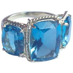 Three Stone Ring with Blue Topaz finished with Rope Twist Border