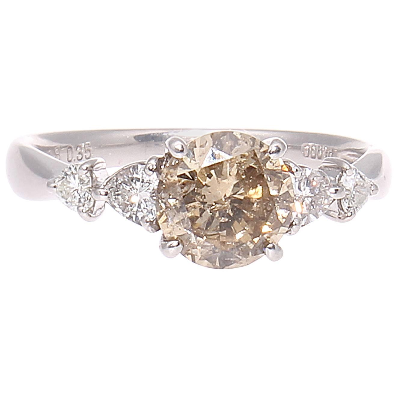 light chagne colored platinum engagement ring
