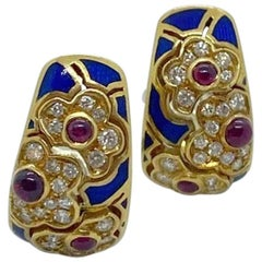 18KT Yellow Gold Earrings with .75 Carat Ruby, .68 Carat Diamond and Blue Enamel