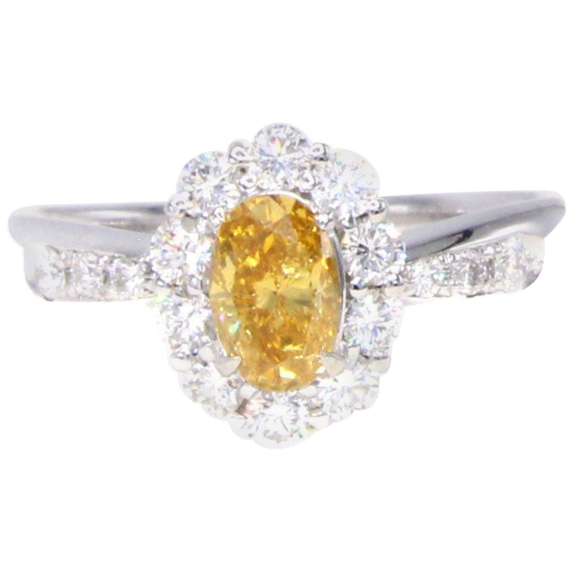 Vivid Yellow-Orange Oval Diamond and White Diamond Platinum Ring