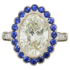 3.37 Carat Oval Diamond with Sapphire Halo White Gold Ring