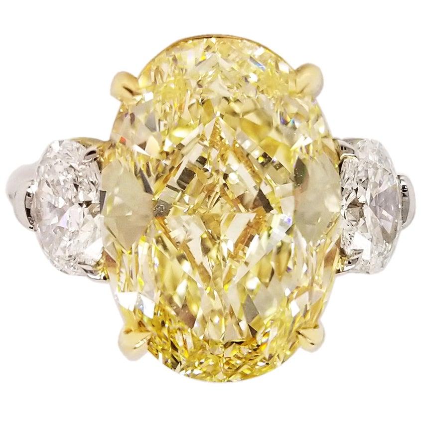 9 Carat Oval Fancy Yellow Diamond Engagement Three Stones Ring GIA