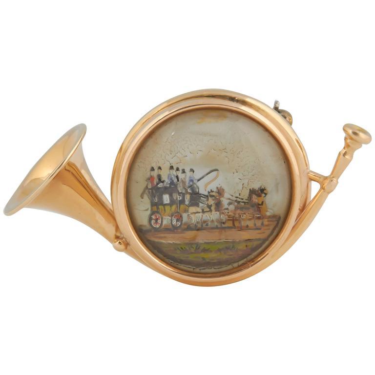 Gold Hunt Horn Reverse Painted Crystal Brooch