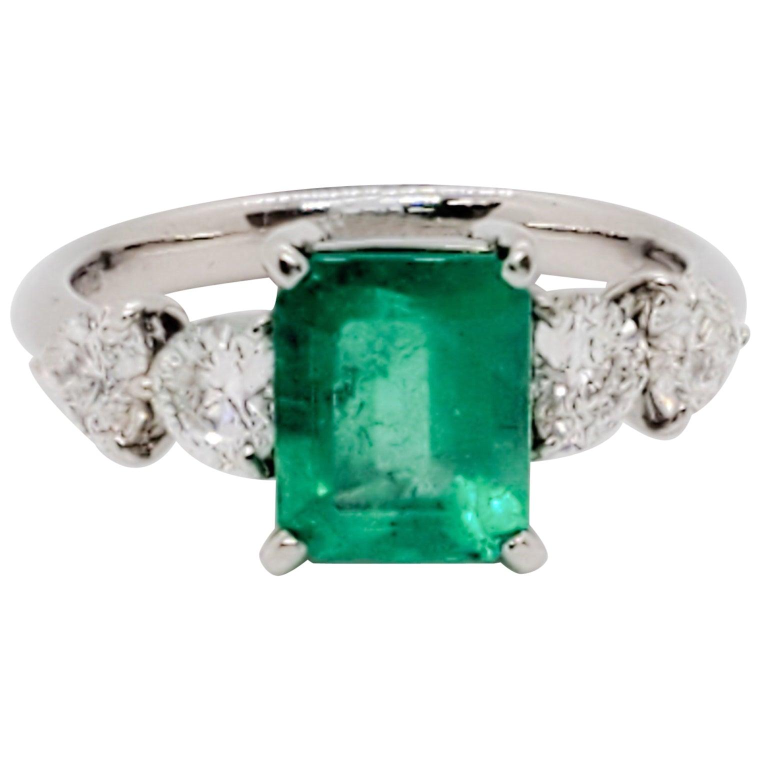 Emerald Emerald Cut and White Diamond Heart Ring in Platinum