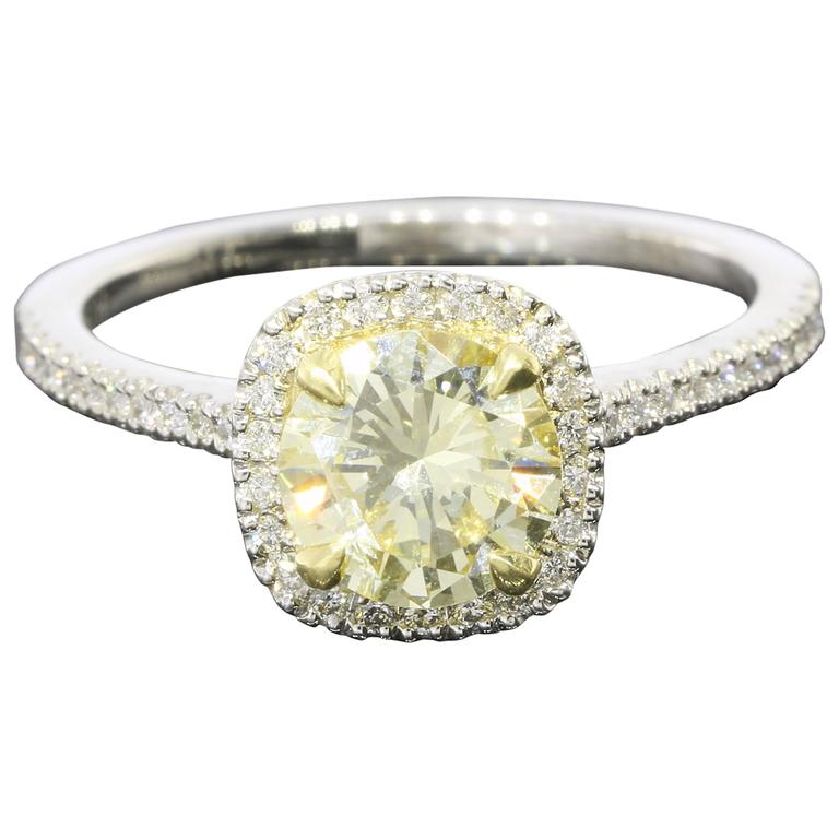 Fancy Light Yellow Canary Diamond gold platinum Halo Ring at 1stdibs