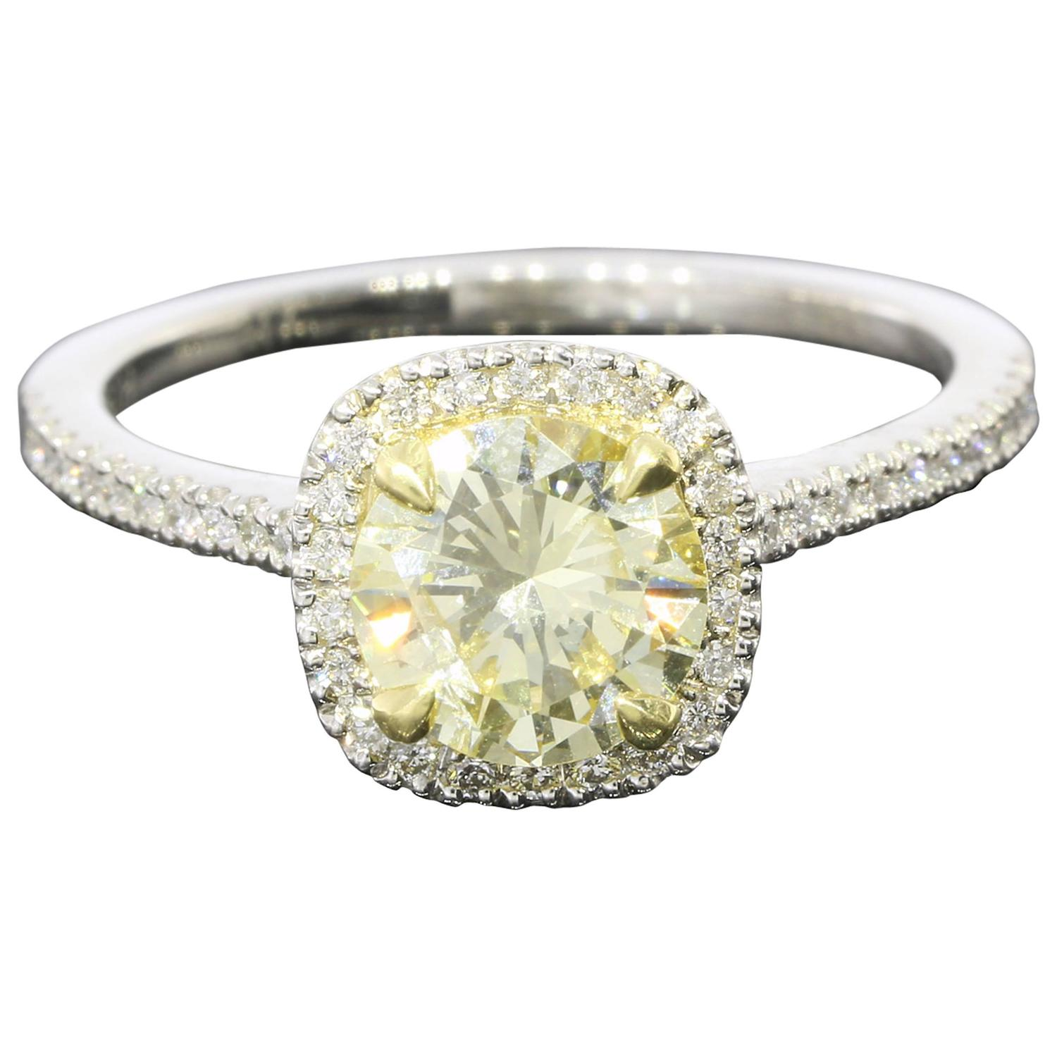 Fancy Light Yellow Canary Diamond gold platinum Halo Ring For Sale at 1stdibs