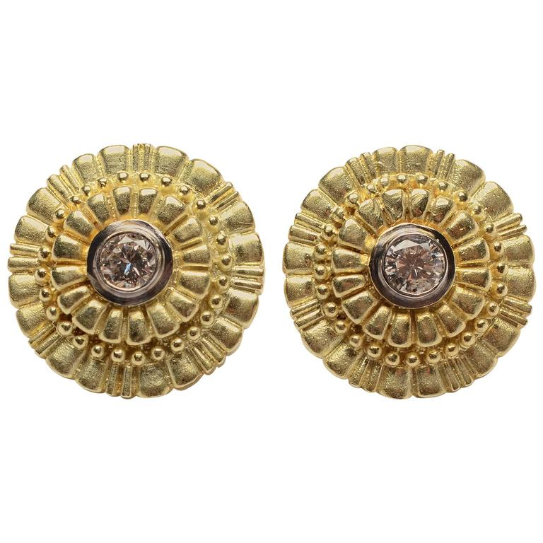 Round Gold Earrings centerd with Diamonds For Sale