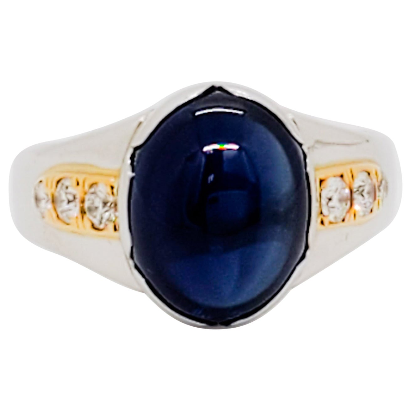 Blue Sapphire Oval Cabochon and White Diamond Cocktail Ring