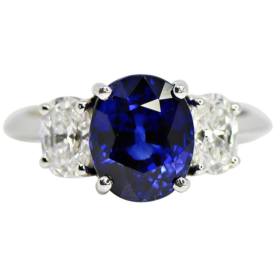 GIA Certified 4.03 Carat Oval Cut Blue Sapphire and Diamond Ring