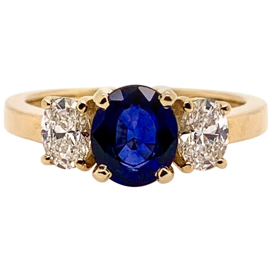 3-Stone Blue Sapphire and Diamond Ring in 18 Karat Yellow Gold
