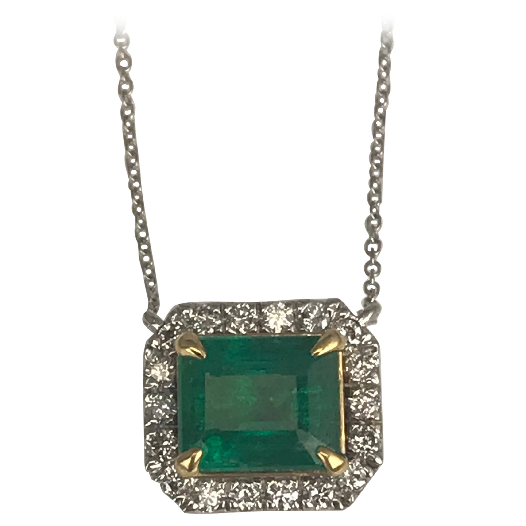 DiamondTown 2.33 Carat Emerald Cut Emerald Pendant with 0.32 Carat Diamond Halo