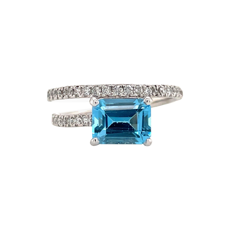 Platinum Blue Topaz Diamond Crossover Ring 1.31 Carats
