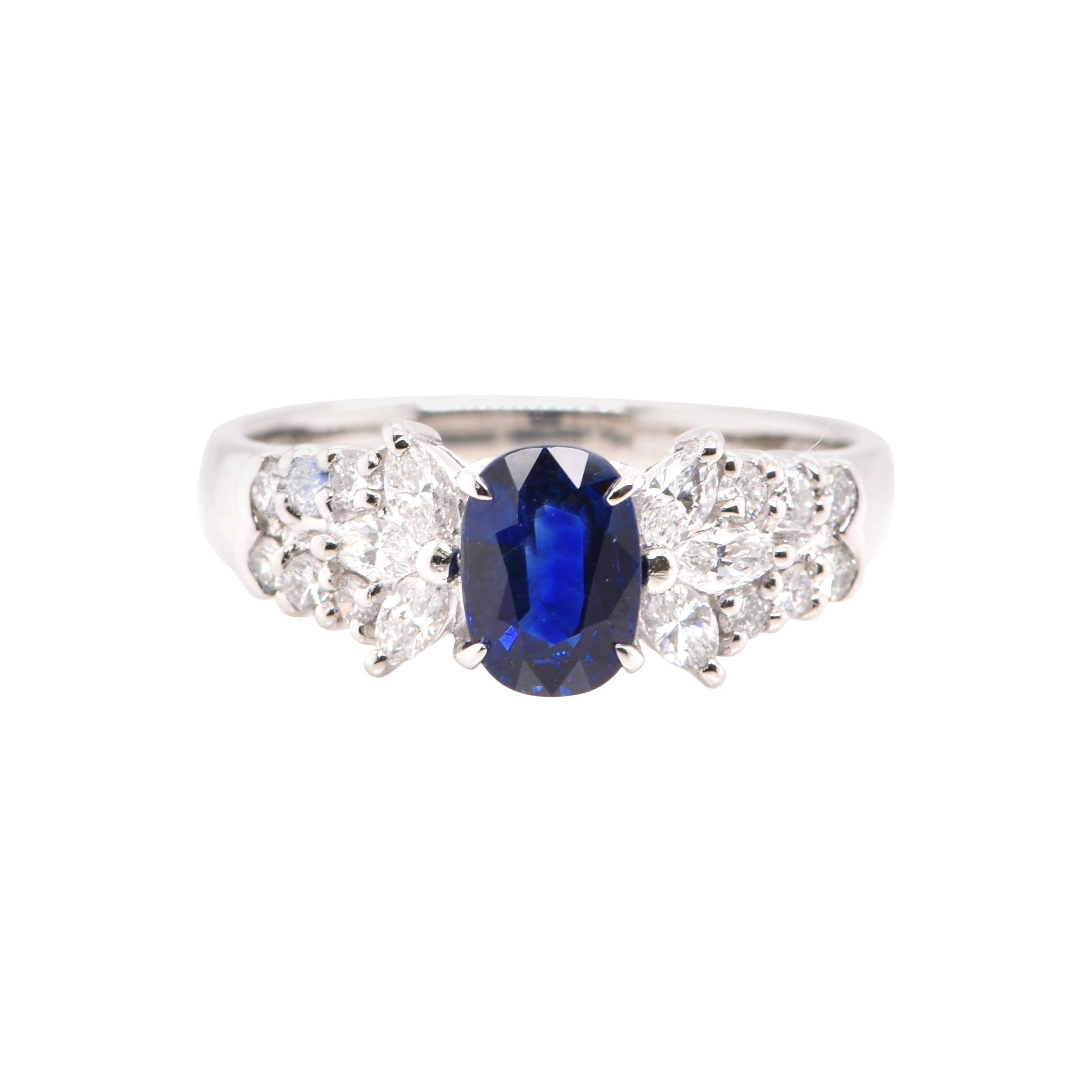 1.23 Carat, Natural Sapphire and Diamond Ring Set in Platinum