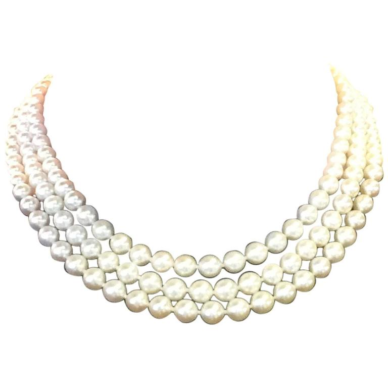 Triple Strand Pearl Necklace with gold clasp