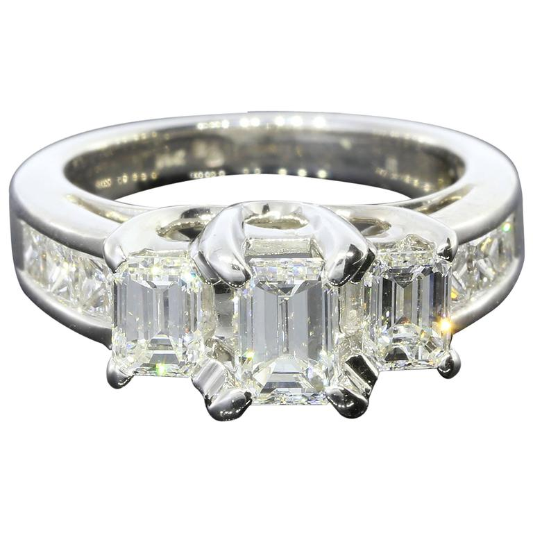 Three-Stone Emerald Cut Diamond Gold Engagement Ring 1