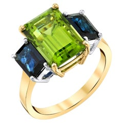 5.57 Carat Emerald Cut Peridot and Sapphire Yellow Gold 3-Stone Cocktail Ring