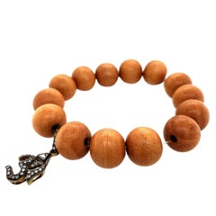 Om Charm Wood Beaded Stretchable Bracelet in Silver and Gold with Diamonds