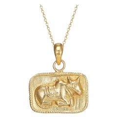 18 Karat Gold, Hand-Carved Amulet Featuring an Image of the Sacred Cow
