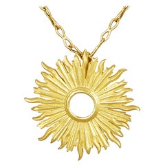18 Karat Gold Handmade Sunburst Pendant Hanging on a 18 Karat Gold Chain