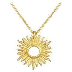 18 Karat Gold Small Sunburst Pendant Hanging on a 18 Karat Gold Chain