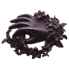 C. 1850 Carved Bog Oak Brooch Depicting a Wreath of Flowers and a Hand