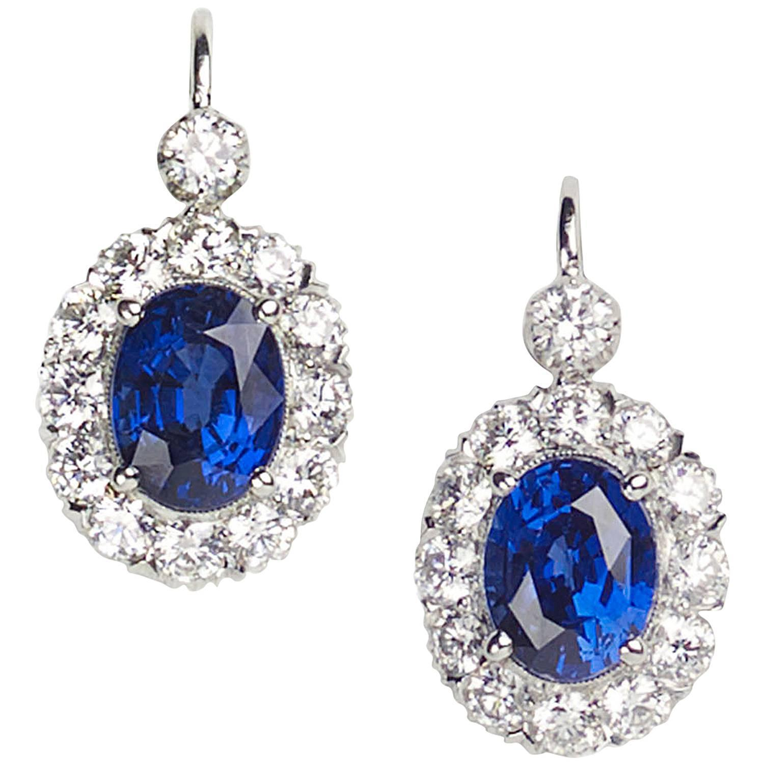 Oval Royal Blue Sapphire Diamond Cluster Earrings at 1stdibs