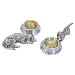 Two Figural Dogs with Gilded Bowls