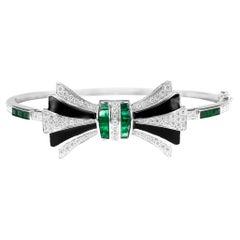 18K Bow Bangle Black Onyx 1.5 Carat Emerald and 1.05 Carat White Diamond