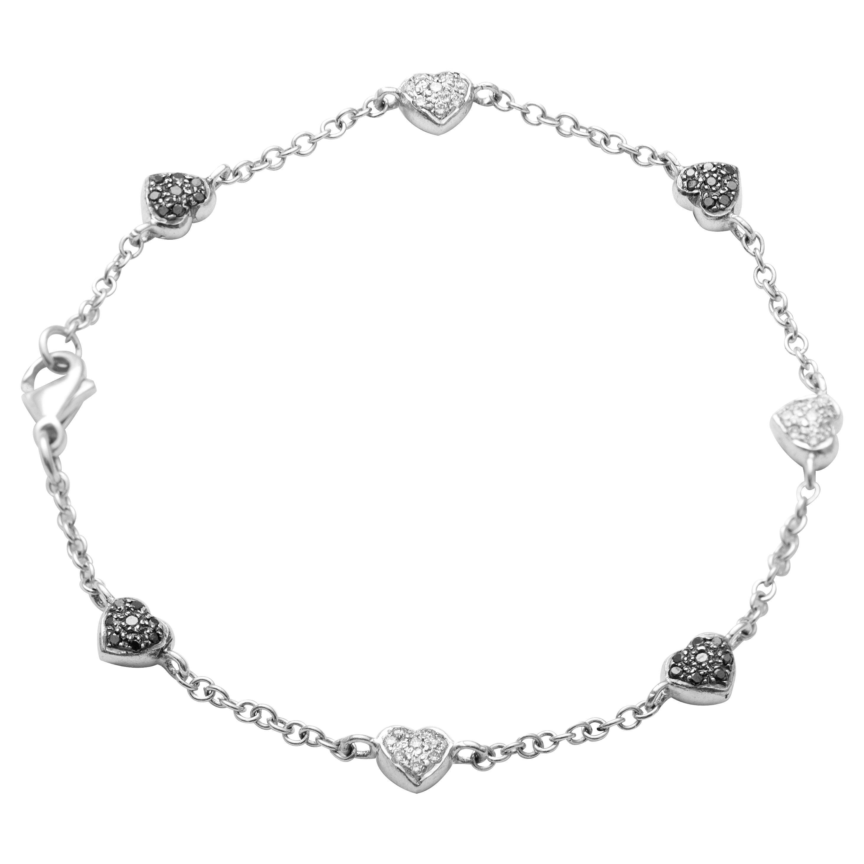 18 Karat White Gold Diamond Charm Bracelet