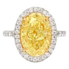 GIA Certified 6 Carat Oval Fancy Yellow Diamond Ring