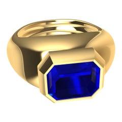 18 Karat Yellow Gold Sculpture Ring with 2.54 Carat Emerald Cut Blue Sapphire