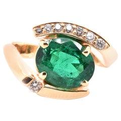 14 Karat Yellow Gold Emerald and Diamond Bypass Ring