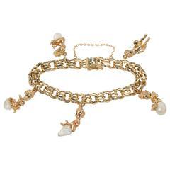 Ruser Pearl Gold Charm Bracelet