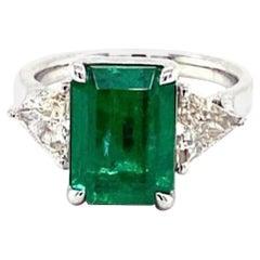 3 Stone Emerald and Trillion Diamond Ring
