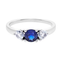 Blue Sapphire and White Sapphire Three Stone Engagement Ring in 18K White Gold