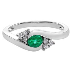 Tension Twist Round Cut Emerald and Diamond Engagement Ring in 18K White Gold